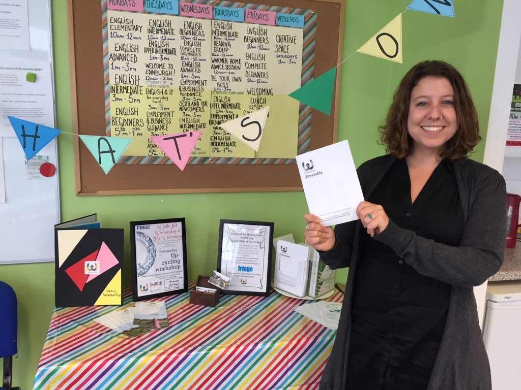Victoria holding up the Welcoming timetable