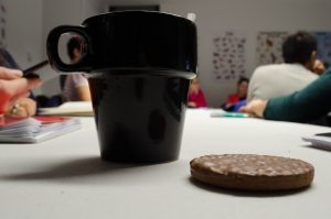 Cup of coffee and digestive biscuit