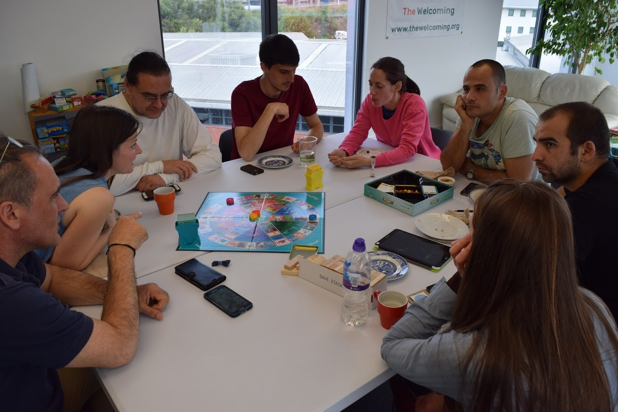 Welcoming participants playing board games at Creative Space