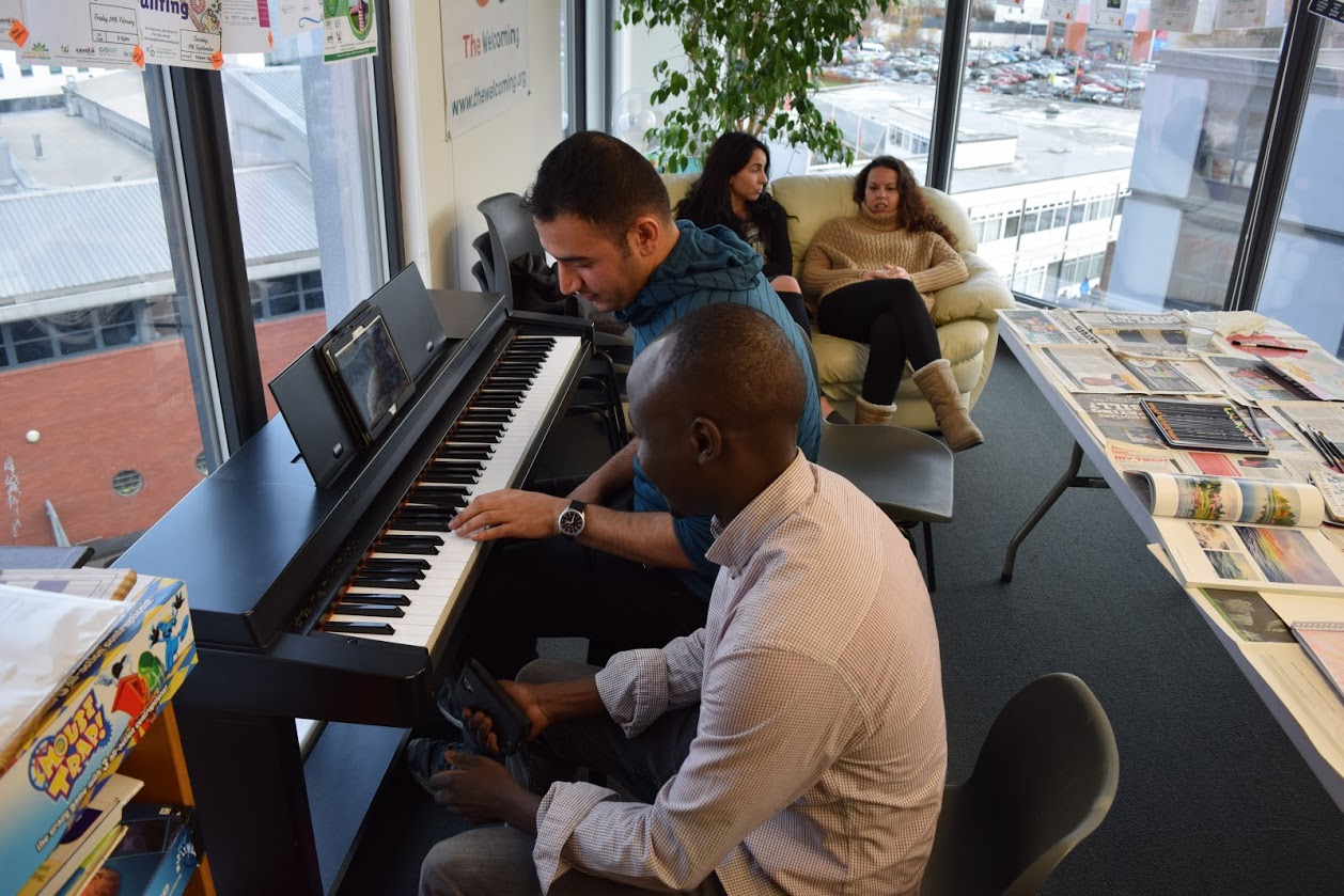 Playing piano at Creative Space