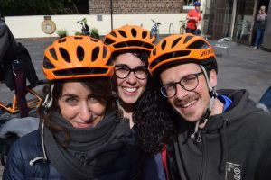 Three cyclists with helmets on
